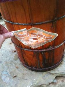 This is our family's ice cream barrel. When you store it, the dried wood pieces kind of rattle about. When you make the ice cream they expand and the only thing holding them together are the metal rings around the bucket. They expand to fit together perfectly and don't leak when you're making the ice cream!