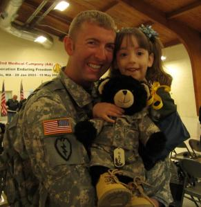 Mya Brown - Sgt. Dan Brown of WI National Guard and daughter Audrey. First day home from tour in Iraq.