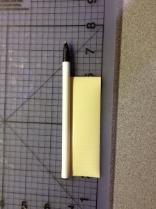 roll piece of tape onto pen leaving room for the cap