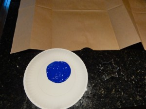 Squeeze out paint onto paper plate