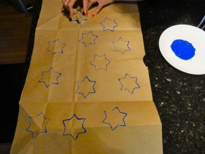 Using cookie cutter or sponge, stamp your own gift wrap this year!
