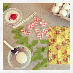 Tear up pieces of paper to get ready to decoupage your egg.